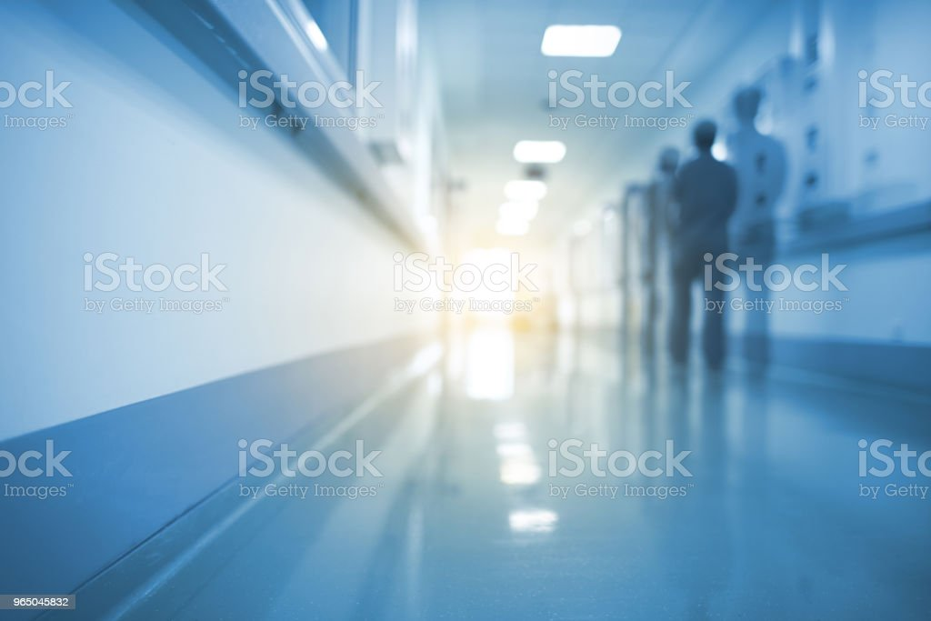 Doubled silhouette of medical worker in hospital hall, unfocused background zbiór zdjęć royalty-free