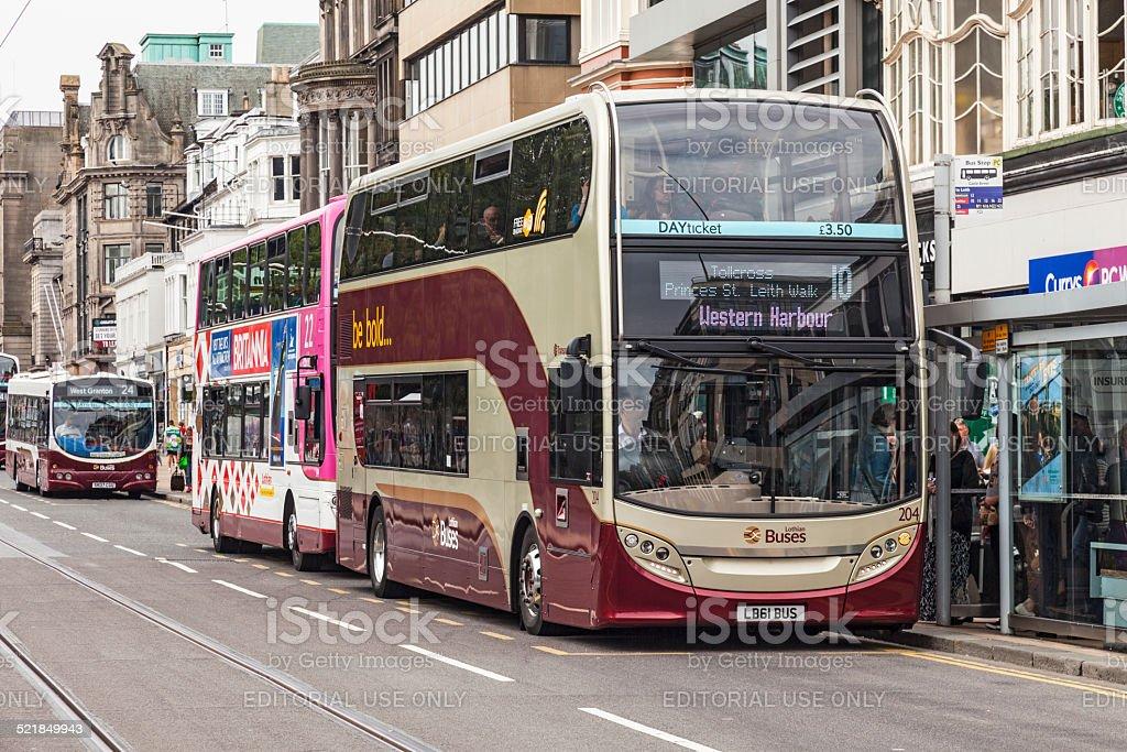 Double-decker busses on Princes Street, Edinburgh, Scotland stock photo