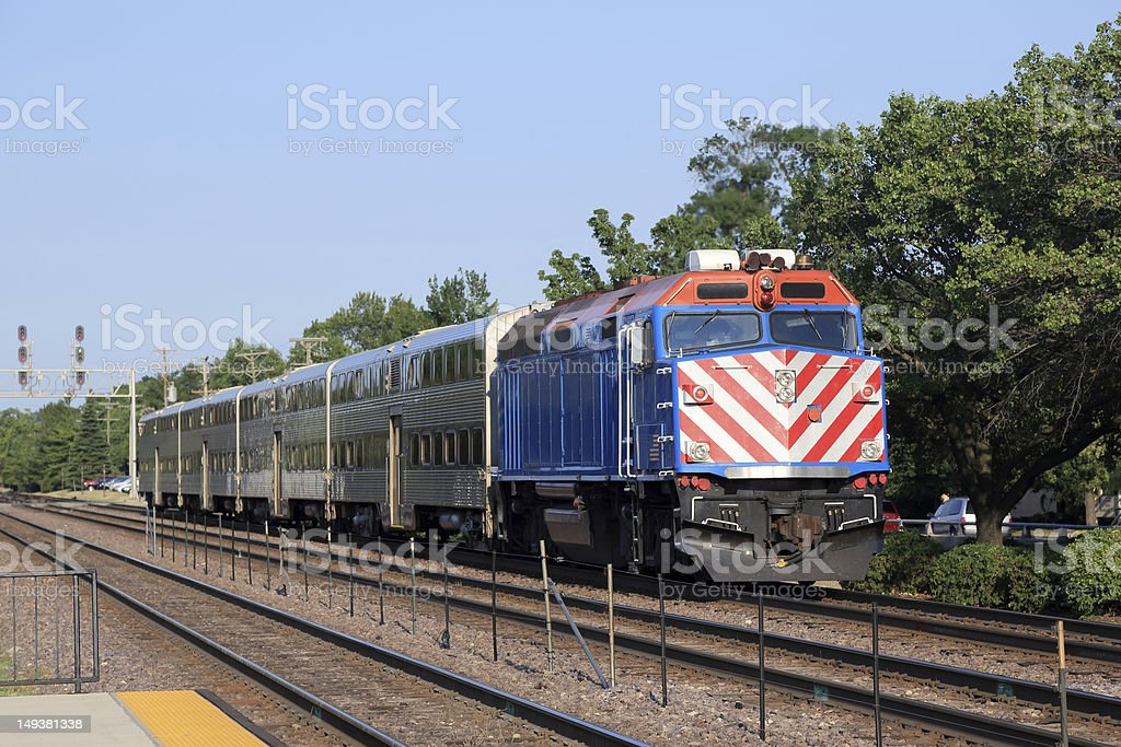 Double-decker commuter train in the suburbs stock photo
