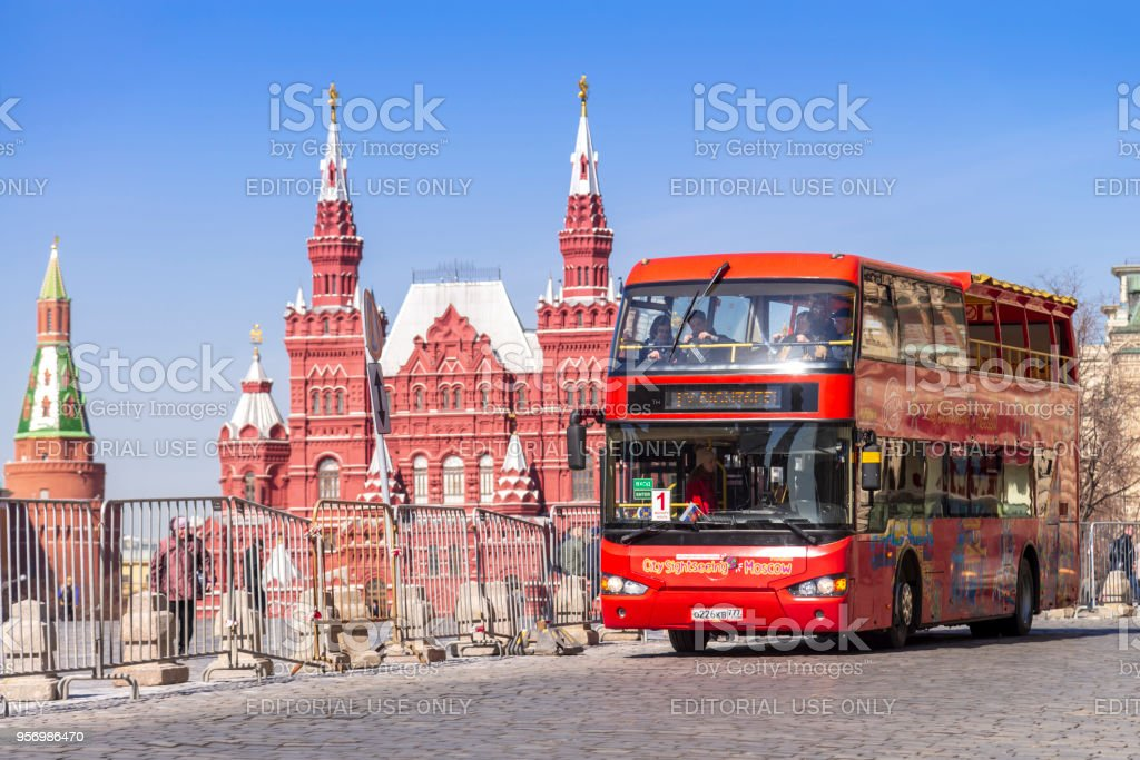 A double-decker moscow city sightseeing tourist bus park at  the Red Square.'n stock photo