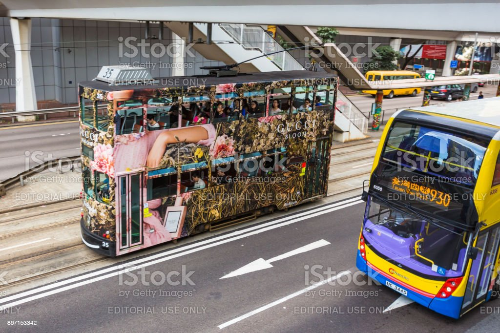 Double-decker tram on street of HK. Hong Kong Tramways is a tram system in Hong Kong, being one of the earliest forms of public transport in the metropolis. stock photo