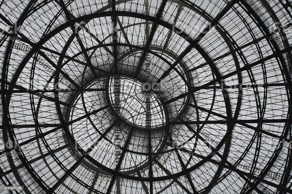 Double-exposure photo of round glass ceiling at two different zooms stock photo