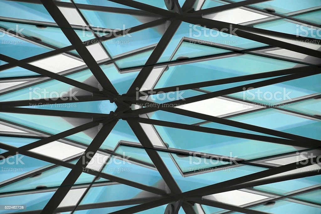 Double-exposure tilt close-up photo of contemporary structural glass roof fragment stock photo