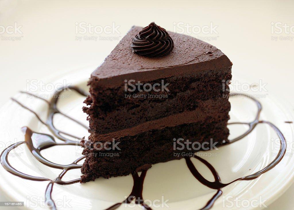 Double-layer chocolate cake with chocolate swirls royalty-free stock photo