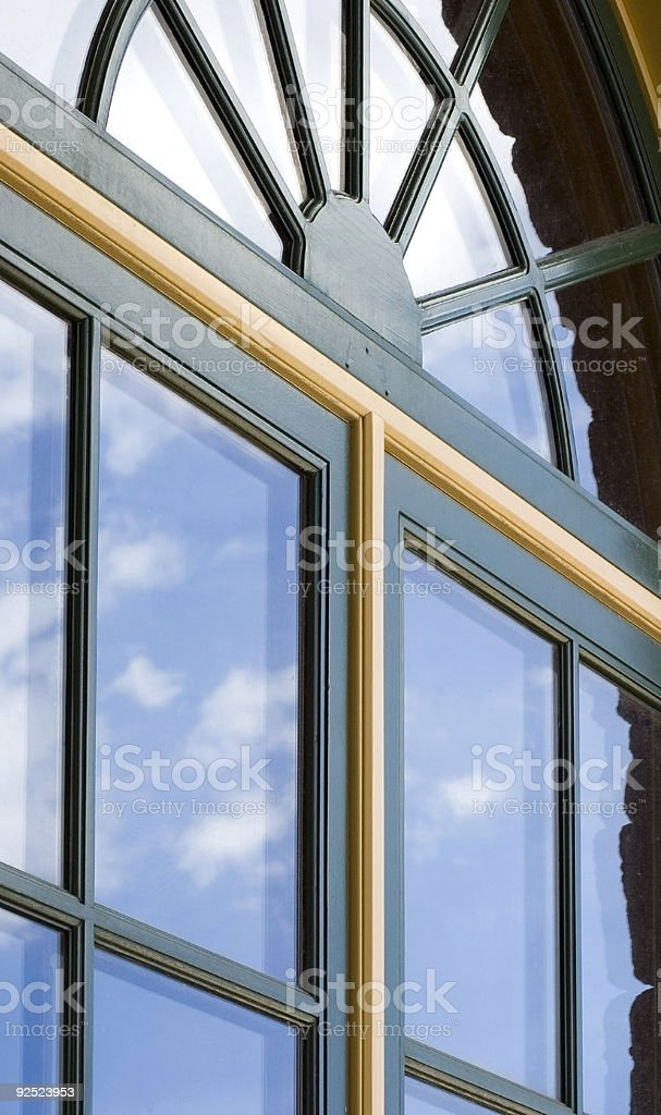 Double-paned Windows with Cloud Reflections stock photo