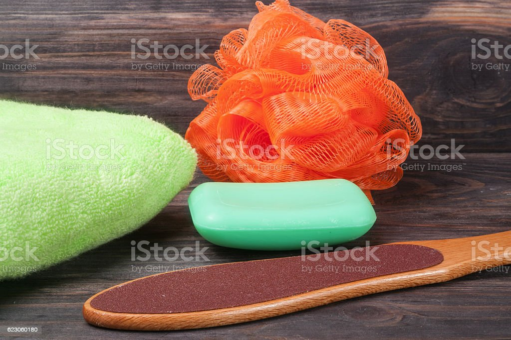 double-sided grater for feet with soap and shower sponge stock photo