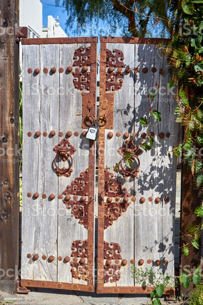 double-wide oriental style garden gates leading to courtyard stock photo