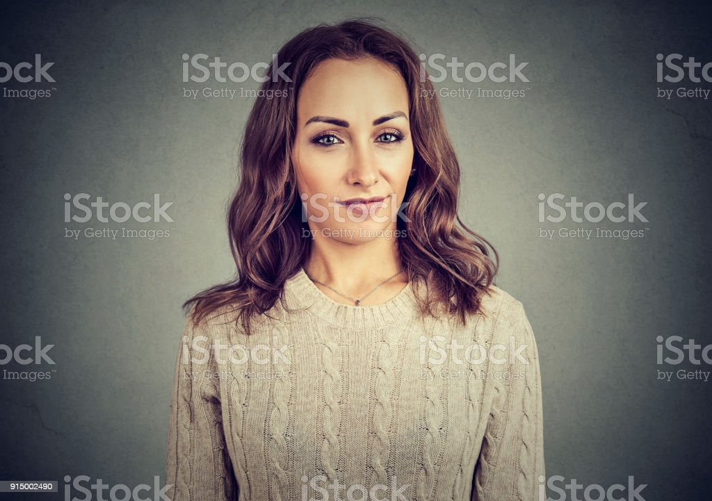 Doubtful model looking at camera with disbelief stock photo