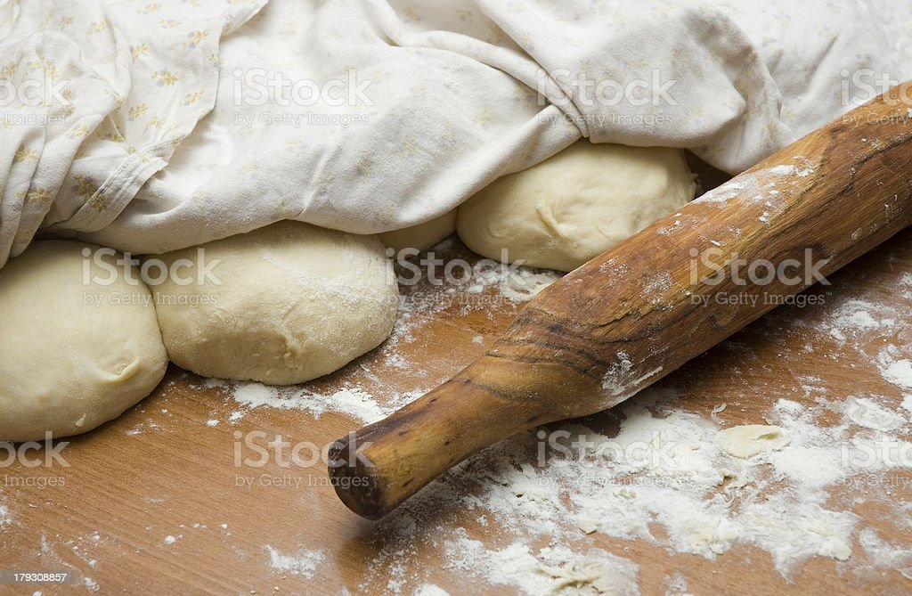 Dough and a rolling-pin royalty-free stock photo