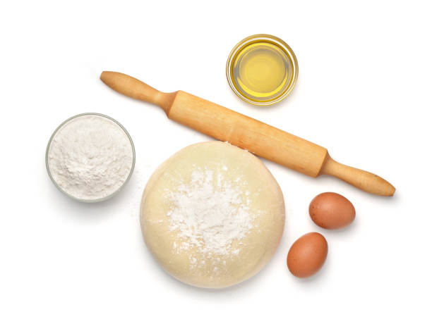 Dough and baking  ingredients Top view of dough and baking  ingredients isolated on white pastry dough stock pictures, royalty-free photos & images