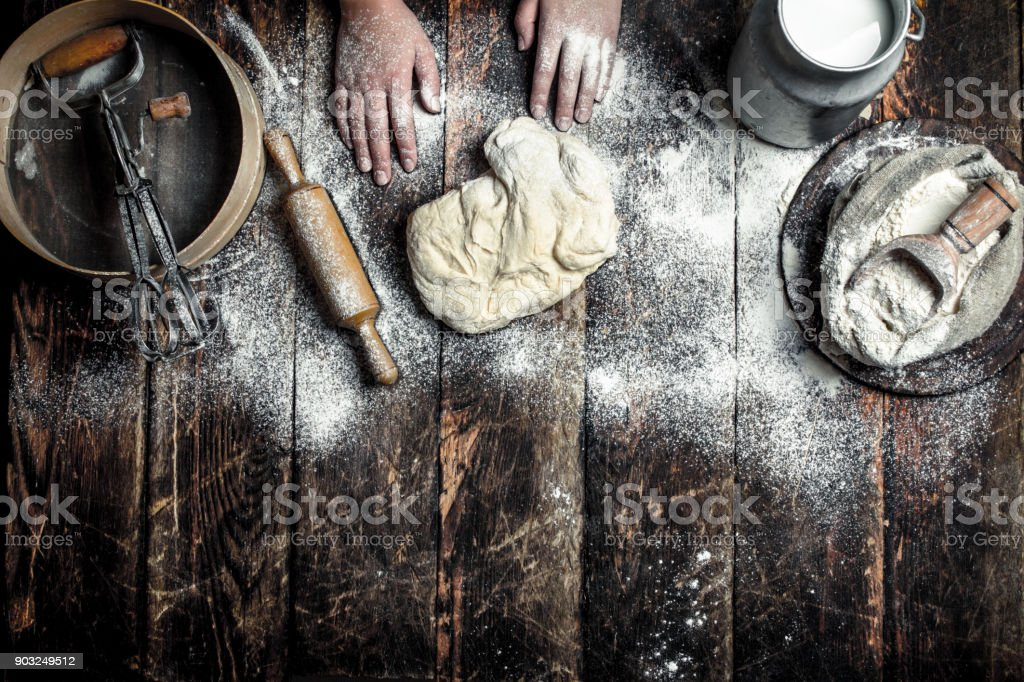 Dough background. Preparation of the dough with the ingredients. stock photo