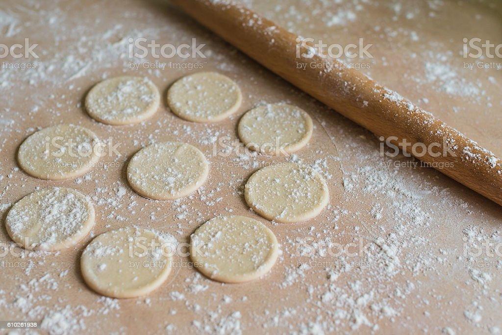 Dough circles and rolling pin stock photo
