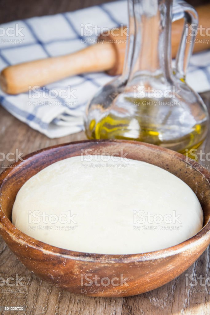 Dough in wooden bowl, yeast for pizza, pasta, cake, pie royalty-free stock photo