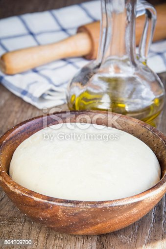 Dough In Wooden Bowl Yeast For Pizza Pasta Cake Pie Stock Photo & More Pictures of Baked