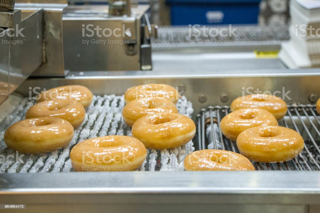 dough nuts on conveyor belt royalty-free stock photo