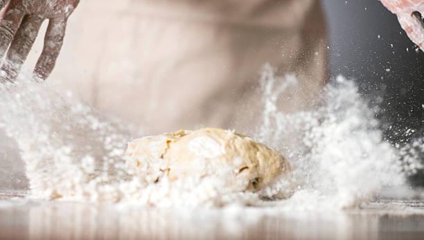 Dough Woman kneading dough. kneading dough stock pictures, royalty-free photos & images