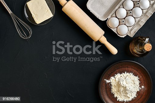 istock Dough preparation recipe bread, pizza or pie making ingredients, food flat lay on kitchen table background. Working with butter, yeast, flour, eggs, oil. Pastry or bakery cooking 916266480