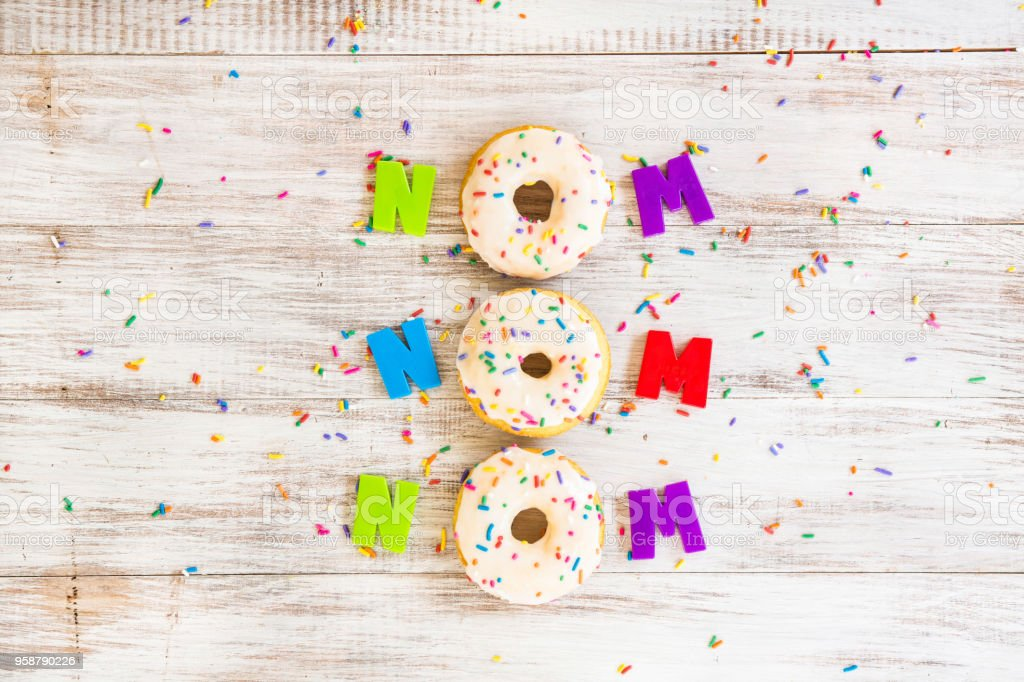 Doughnut Saying On Board With Sprinkles stock photo
