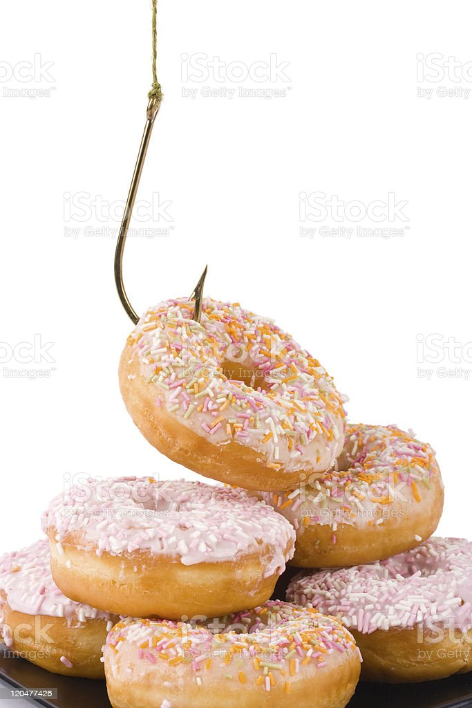 Doughnuts being hooked stock photo