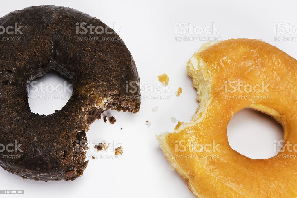 Doughnuts with a bite and crumbs. stock photo