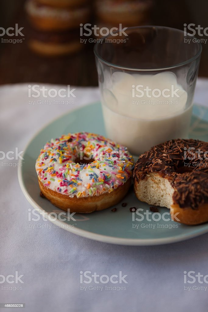 Doughnuts with glass of milk royalty-free stock photo