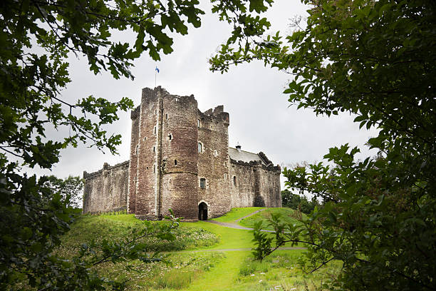 "Doune Castle ""The 14th century Doune Castle near Stirling, Scotland, seen through trees.Doune Castle is perhaps most famous as the location for several scenes in Monty Python and the Holy Grail."" theasis stock pictures, royalty-free photos & images"