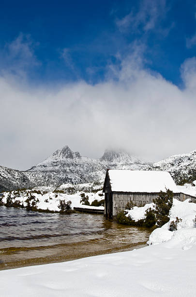 dove lake boat house in snow, cradle mountain, tasmania - cradle mountain stock photos and pictures