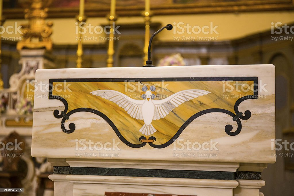 Dove on marble altar of the church stock photo