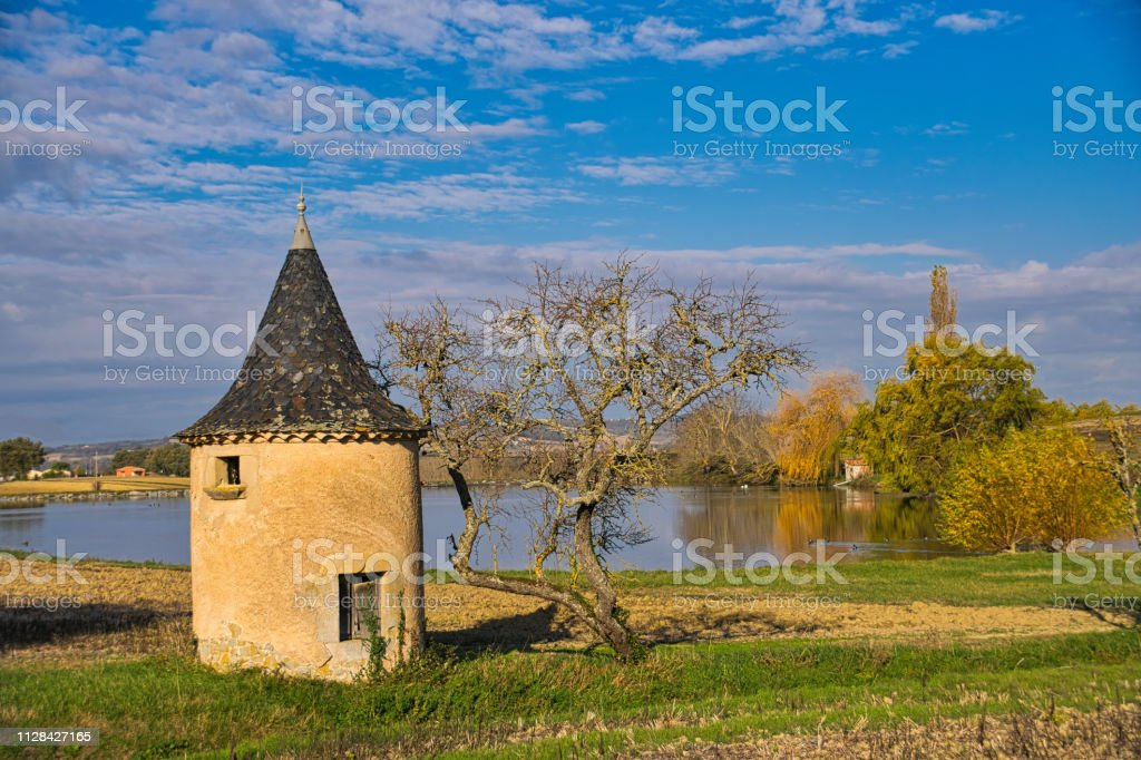 Dovecote in front of a lake stock photo