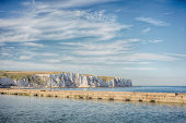istock Dover port, White Cliffs in background, England, UK 470785651