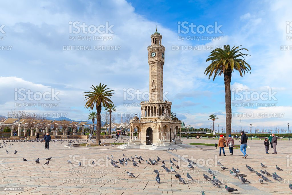 Doves and walking people on Konak Square, Izmir stock photo