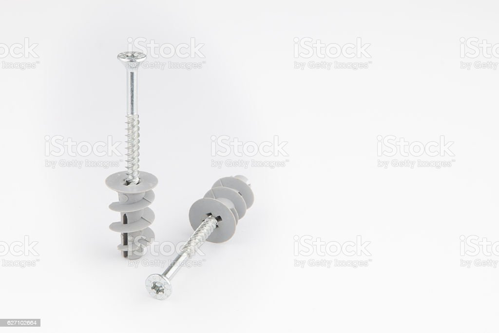 Dowel pin or wall plugs and screws for gypsum board stock photo
