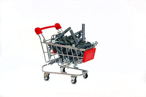 Dowels gray in the shopping cart on white