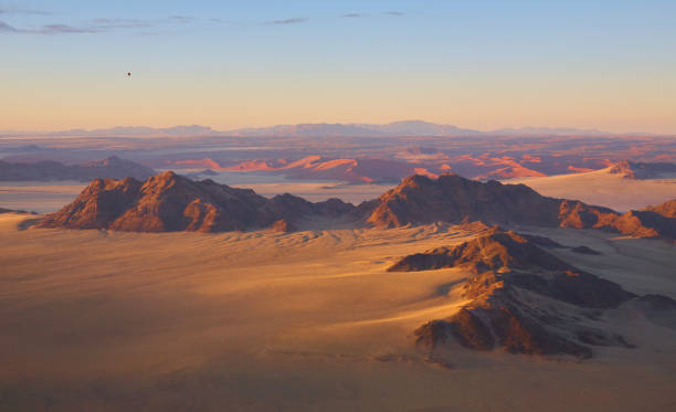 Down over the Namibi Desert Ballooning at dawn is the best way to see the majesty and extent of this beautiful desert. namib desert stock pictures, royalty-free photos & images