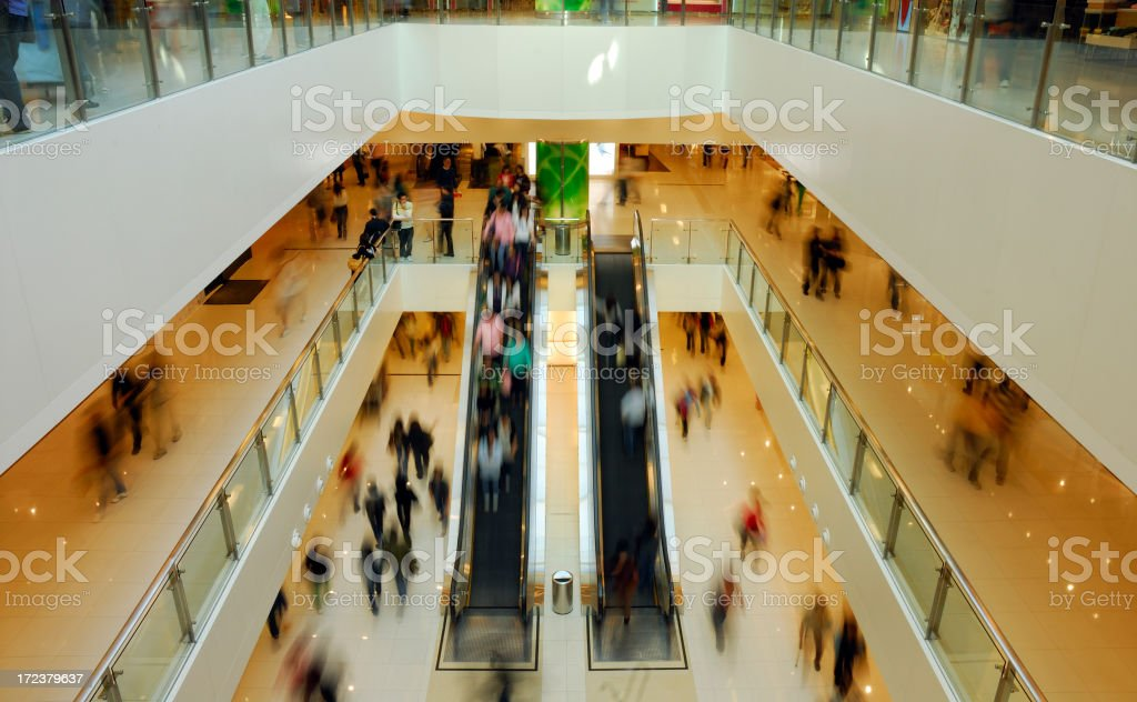 Down perspective and blurred image of shopping mall royalty-free stock photo