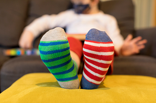 Different socks as symbol of down syndrome. Selective focus.