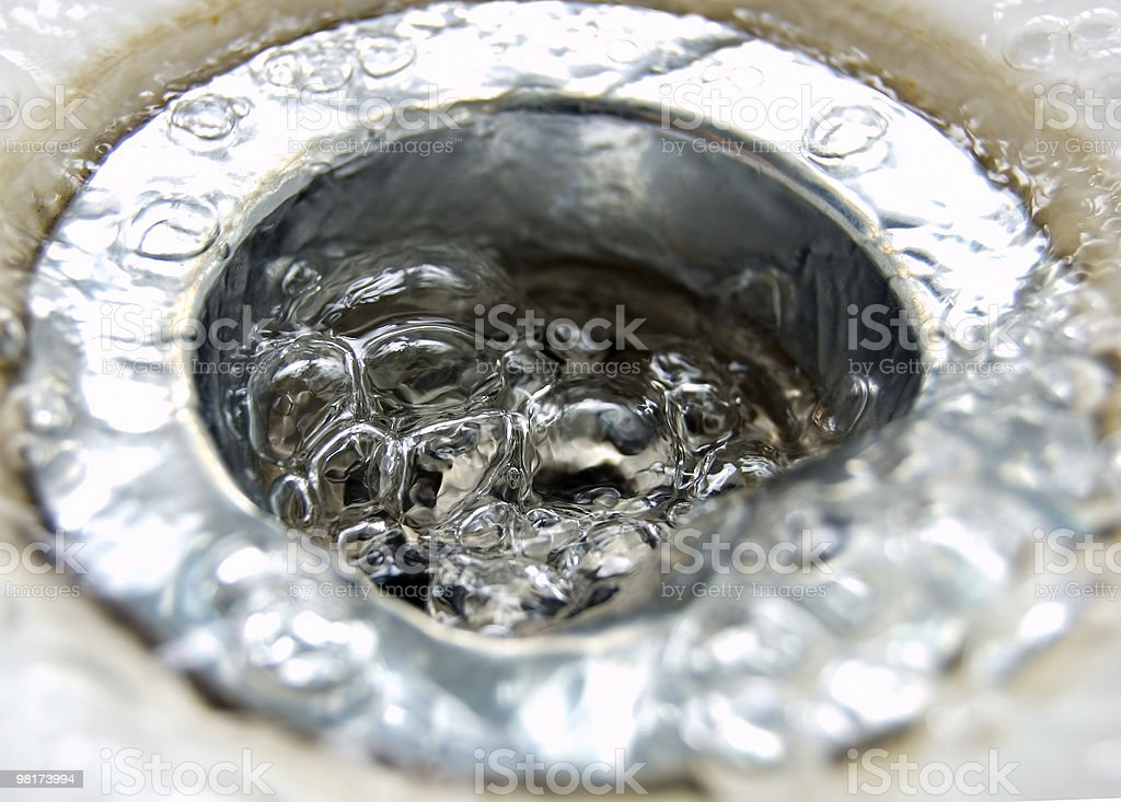 Down the drain royalty-free stock photo