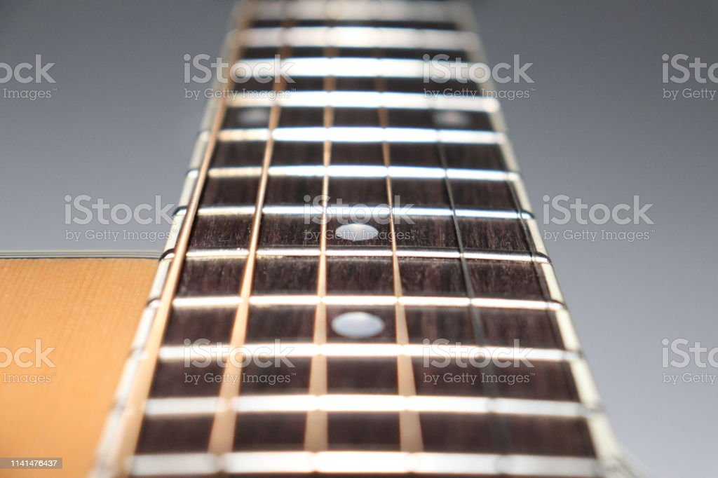 The neck of a guitar close up 6 string