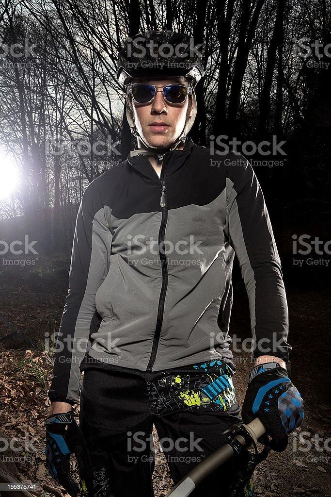 Downhill enduro mountain bike biker portrait in the woods. royalty-free stock photo