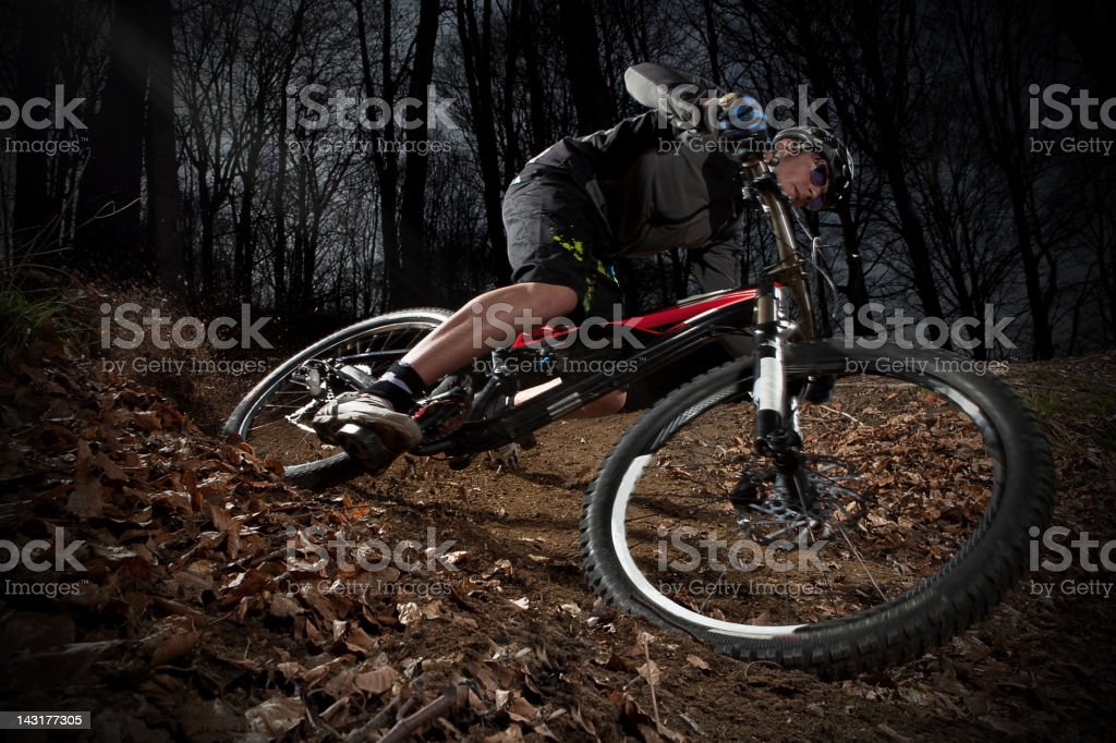 Downhill enduro mountain bike curve in the woods royalty-free stock photo