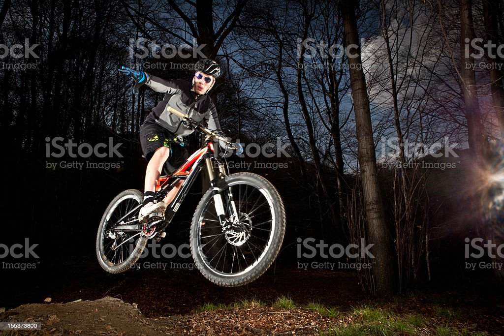 Downhill enduro mountain bike jump in the woods royalty-free stock photo