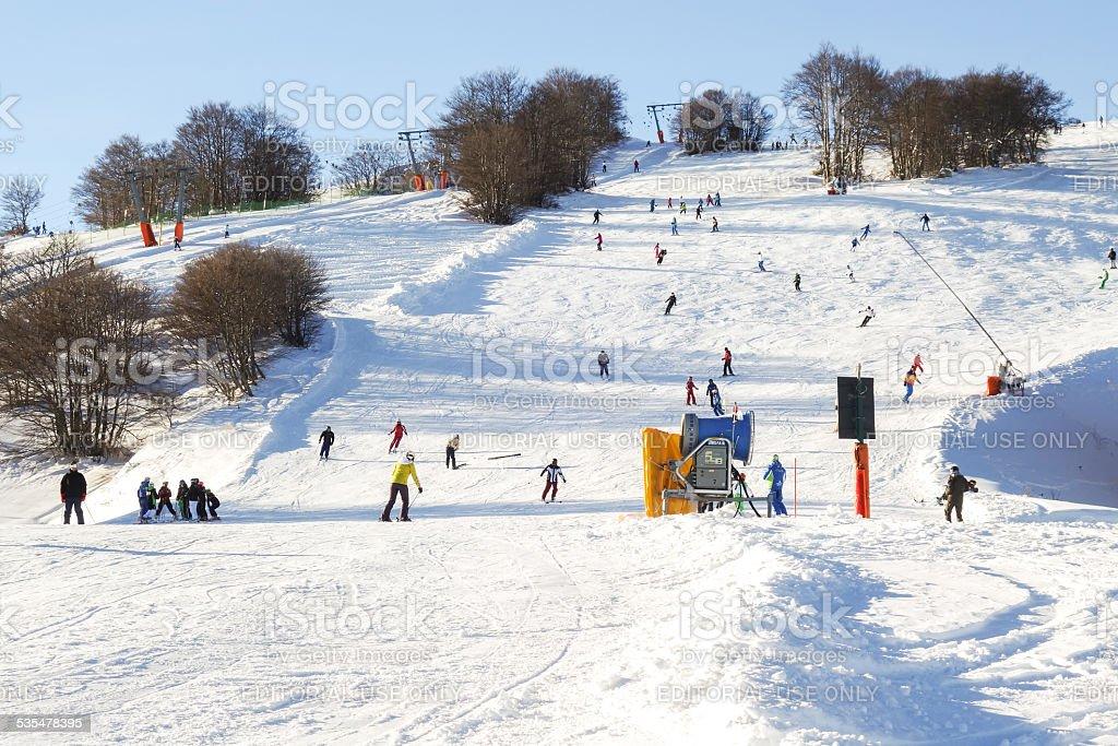 Downhill on ski slopes stock photo