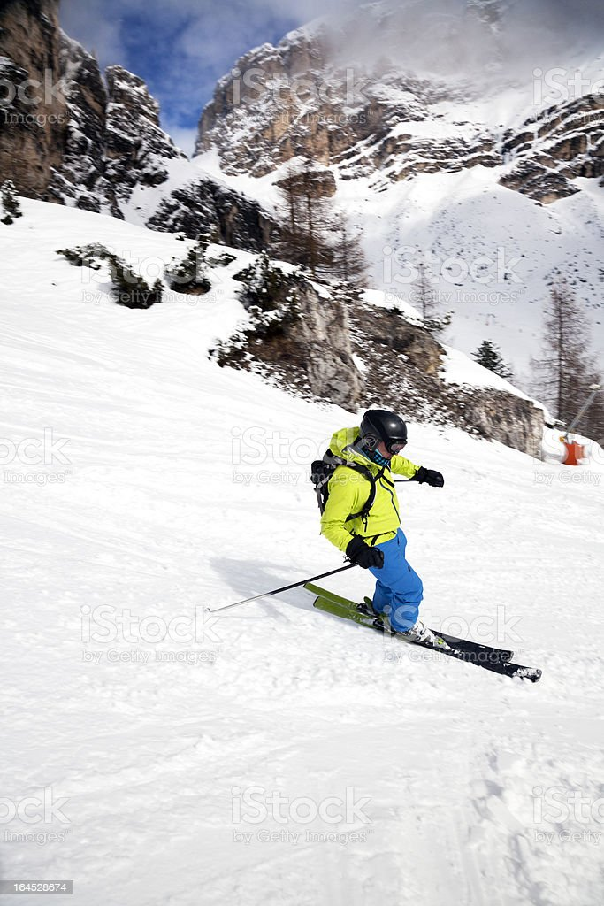 Downhill Skier in Dolomites, Italy stock photo