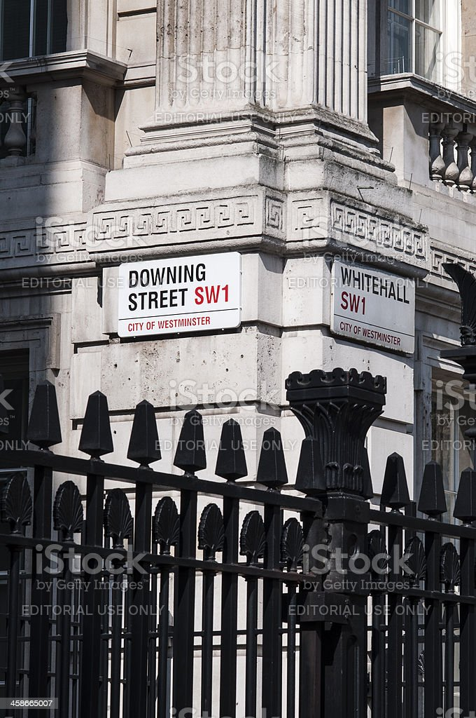 Downing Street nameplate in the corner with Whitehall royalty-free stock photo