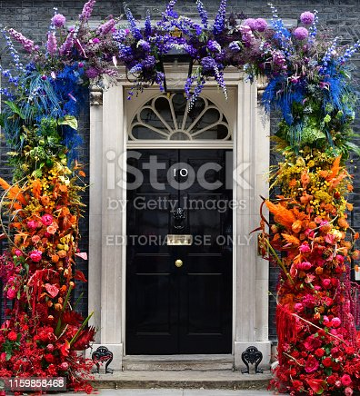 10 Downing Street, the official residence and office of the British Prime Minister with its famous front door decorated in a floral rainbow celebrating UK London LGBTQ Pride week