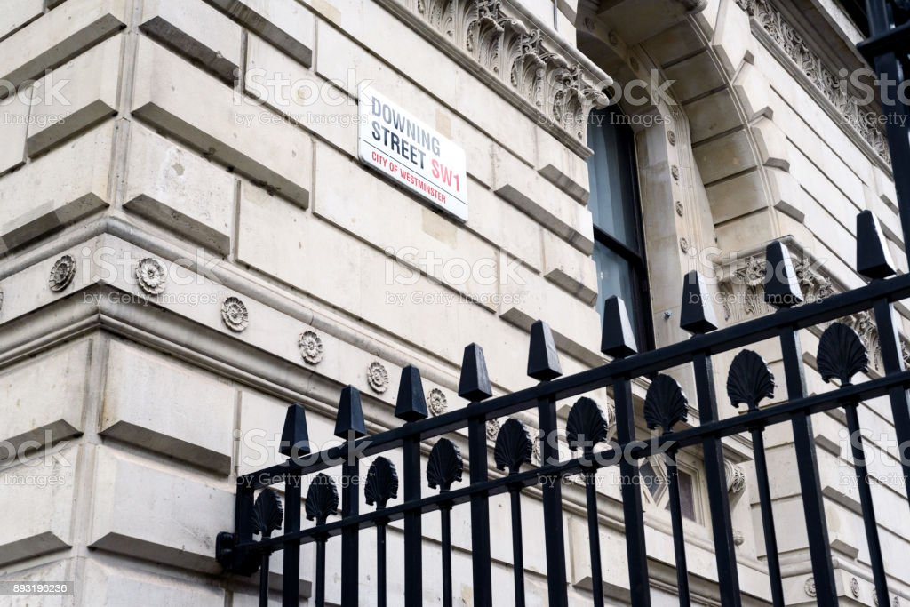 10 Downing Street Sign and Black Security Fence stock photo