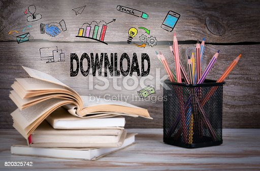 istock Download, Business Concept. Stack of books and pencils on the wo 820325742