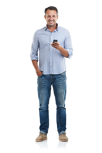 Full length portrait of a handsome man checking his phone against a white backgroundhttp://195.154.178.81/DATA/i_collage/pu/shoots/785221.jpg