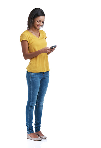 Studio shot of a young woman using a cellphone against a white backgroundhttp://195.154.178.81/DATA/i_collage/pu/shoots/806341.jpg