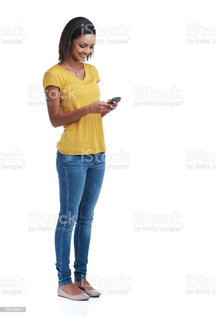 Downloading cool new apps for her phone stock photo
